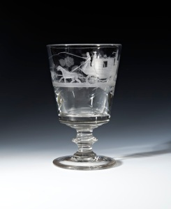 A good rummer, the bucket bowl engraved with a mail coach and four horses, the reverse with initials GB Height 16.2 cms c.1820-30, English Glass Delomosne & Son Ltd.