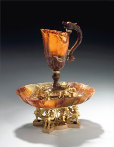 THE HAMILTON PALACE AGATE EWER A rare and precious objet d'art from the late 1790s, combining a richly veined 17th century agate ewer and basin with fashionably neo-classical gilt-bronze mounts possibly by Pierre-Philippe Thomire, the design attributed to Jean Guillaume Moitte, has a remarkable history Estimate: £500,000-800,000 CREDIT: CHRISTIE'S IMAGES LTD. 2015