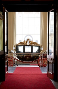 The Australian State Coach, on display at the Grand Entrance. It is used as part of the arrival procession on the first day of a State Visit. Royal Collection Trust (c) Her Majesty Queen Elizabeth II, 2015