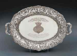 Royal George III presentation tray, London, 1815. Maker's mark of Paul Storr for Rundell Bridge & Rundell Designed by Thomas Stothard Presentation from H.R.H. The Prince Regent to General Thomas Garth, 2nd May 1816 Length: 32 7/8 in (83.5cm) over handles, Weight: 313oz. 1 dwt (9,749gr) The case: 35in (89cm)