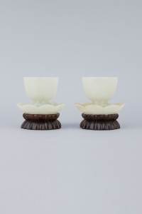 A pair ofwhite jade cups with their original stands in the form of lotus petals, dating from the 18th Century Marchant www.marchantiques.com