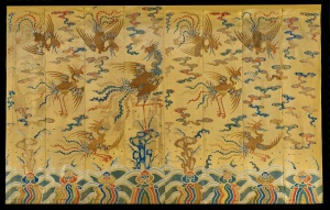 A pair of imperial, yellow silk monumental hangings, decorated with phoenix as symbols of the empress. The hangings, each composed of eight panels, form a mirror-image pair and are woven with nine phoenix in gold thread amongst five coloured clouds and above rocks and waves. Chinese, Qianlong period, 1736-1795 Height: 3.45 m (11 ft. 4 inches) Width of each hanging: 5.68 m (18 ft. 8 inches) Provenance: Private European family since c. 1912 Jacqueline Simcox Ltd www.jacquelinesimcox.com