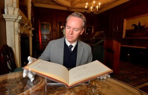 Keith Lodwick, Curator, Department of Theatre and Performance, Victoria and Albert Museum, London checking out the names in the guest book of from the Olivier home © National Trust / North News Agency