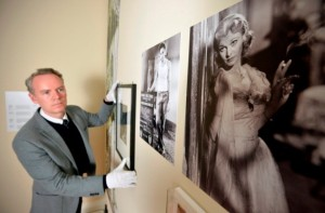 Keith Lodwick, Curator, Department of Theatre and Performance, Victoria and Albert Museum, London finishing the hang in the Streetcar Named Desire room © National Trust / North News Agency