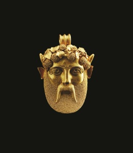 A gold pendant in the form of a Bacchante. Attributed to Castellani or Giancinto Mellilo, c 1870