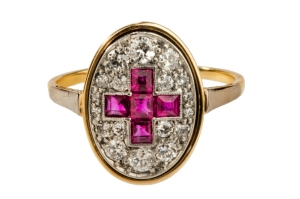 Rare red cross ring in 18ct gold and platinum, pavé set with twelve 0.5 carat diamonds and the red cross made up of five Burmese rubies, c1915, T Robert