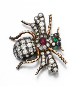 Lot 433 - Gem set and diamond brooch, late 19th century Estimate 1,000 — 1,500 Designed as a bumblebee, set with circular-cut diamonds, the body and head accented with a cabochon ruby and a circular-cut emerald, with sapphire eyes.