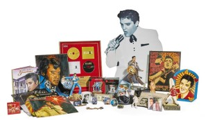 "Lot 47 - Her Grace's Collection of Elvis Presley Ephemera Estimate 500 — 1,000 comprising: An E.P.E. Official Product Telemania limited edition novelty 'Singing and Dancing Telephone' (C) 1996, cased Two key-rings A small printed circular box Two plastic bags from Graceland An 'Easy Come Easy Go' record, published Camden Records, 1972, now moulded into a bowl A simulated 'Elvis' 1 dollar note Five Elvis fridge magnets A 'Tiny Tomes / Elvis The Legend' miniature book Two Elvis button fridge magnets Two small tins of breath mints A printed fabric hanging 'Graceland' from the Andy Warhol Collection produced by Andrew Martin Elvis Presley's Graceland, The Ultimate Graceland Tour DVD, Elvis Presley Foundation 2007 'The King' printed porcelain mug A Franklin Mint wristwatch hung with charms, cased A tin of Elvis Presley playing cards Two further packs of playing cards Two RCA cassettes 'Amazing Grace - His Greatest Sacred Performance' A portable 'Legends' ashtray A 'Legends' lady's compact mirror Two German magazines with accompanying DVD free gift A tin sign printed 'He Dared to Rock July, 5, 1954, That's All Right' Five Christmas Tree Elvis inspired decorations A polychrome resin Elvis and surfboard ornament A 'Bradford Exchange' King of Rock and Roll ornament A painted ceramic wall plaque by Janice Raynor, A Ms Understood Prod. 2007, titled That's Alright Mama, exhibited Elvis's Teddy Has Left The Building, Newtown NSW, Australia A Zadig & Voltaire printed navy long sleeve t-shirt 'Love Forever Elvis', size large A knitted British new wool Elvis Presley scarf by Jean Birch-Leonard A Wrebbit 350 piece 3-D jigsaw puzzle of Graceland A modern The King birthday card and plain Born to Rock postcard A 'Grow The King' expandable toy Alf Burnell, three quarter length portrait of Elvis Presley, acrylic on canvas A pair of Mexican Elvis bottle top pendant evening earrings An E.P.E. cardboard cut-out, (almost life-size) of 'The King' Mann, May, Special Collector's Edition, Elvis and the Colonel, Drake Pub. Ltd. New York, 1977 Keogh, Pamela Clarke, Elvis Presley, The Man. The Life. The Legend., Simon & Schuster, London, 2004 Presley, Lisa Marie (fwd), Elvis Presley's Graceland, Official Guidebook, E.P.E. Graceland, rev. ed. 2009 An E.P.E. 2011 Official Elvis Calendar BMG records presentation disc set, framed and glazed, Presented to The Duchess of Devonshire / In recognition for her continued support of Elvis Presley from BMG records and The Day Team at Chatsworth Five Elvis Presley records Two Boxed sets of CD compilations, one with commemorative 'Collectable Stamps' A vintage Elvis Presley pocket knife printed 'Elvis Presley King of Rock n' Roll 1935-1977' Three modern photographic prints of Elvis Presley (two the same image) An RCA 7"" of The Wonder of You and Mama Liked the Roses, 1974 An Elvis / Summer Festival / Las Vegas Hilton / Complimentary Menu Hand, A (ed.) Elvis Monthly, no. 5, 5th Year, 1964 Four modern photographic prints by Alfred Wertheimer; Going Home; Elvis Sings to the Hound Dog; A-Frame; Grilled Cheese 20 Cents, published by the New York Times, each signed l/l in ink by A. Wertheimer"