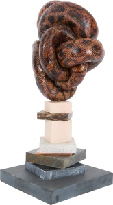 Polly Morgan Mouthing the Words Taxidermy Rainbow Boa Granite, marble, copper, palmwood, perspex and lemonwood 420 x 220 mm Base 180 x 180mm Courtesy Other Criteria © Polly Morgan