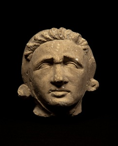 ARCADIA CERRI Exhibition: Early European Sculpture Head of a man frowning Champagne, Reims Second third 13th century fossiliferous limestone 13 x 13 x 13 cm