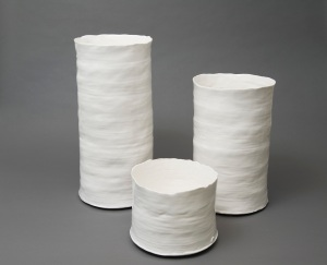 BRIAN HAUGHTON GALLERY White porcelain cylinders hand thrown by Gunilla Maria Akesson, leading contemporary Swedish ceramic artist. Range in size from 7 ins (18 cm) through to 18 ins.