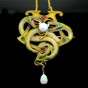 LUCAS RARITIES An enamel, opal, emerald, and ruby serpent pendant by Gustave-Roger Sandoz. 9.5cm X 6.5cm. Circa 1901