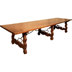 "Wakelin & Linfield An unusually large late 19th century two plank Spanish table in walnut with carved decoration to the legs and original ironwork supports to the base. L144"" x W39"" x H30.25"" In the region of £25000 Provenance: Orson Welles"