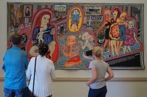 Visitors looking at the Grayson Perry Tapestries Credit: Peter Young