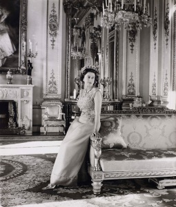 Queen Elizabeth II standing in the White Drawing Room, Buckingham Palace. Official portrait by Cecil Beaton, 1968 Royal Collection Trust / (C) Her Majesty Queen Elizabeth II 2016.