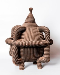 Jeremy Sabine A 19th century Zulu wooden vessel carved from a single block of wood with no joins, half a metre tall