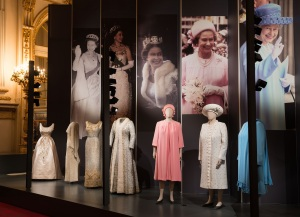 A display of dresses from Fashioning a Reign: 90 Years of Style from The Queen's Wardrobe on display at Buckingham Palace. Royal Collection Trust /© Her Majesty Queen Elizabeth II 2016.