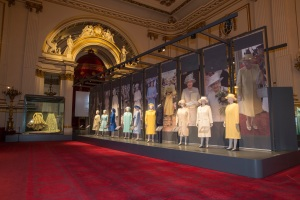 A display of dresses on show at Fashioning a Reign: 90 Years of Style from The Queen's Wardrobe at the Summer Opening of Buckingham Palace, including Her Majesty's wedding dress by Sir Norman Hartnell, 1947 (far left) Royal Collection Trust /© Her Majesty Queen Elizabeth II 2016.