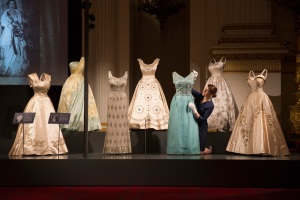 A display of evening wear from Fashioning a Reign: 90 Years of Style from The Queen's Wardrobe on show at Buckingham Palace. Royal Collection Trust /© Her Majesty Queen Elizabeth II 2016.