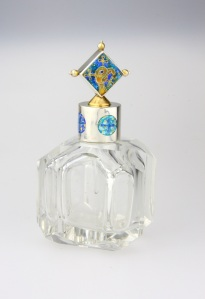 Joan Mackarell: Celtic perfume bottle Silver, enamel, up-cycled glass bottle 8 x 10 cms Cloisonné Joan finds the old bottles in antique shops and then designs and makes new tops in silver and enamel which are inspired by the bottle shapes.