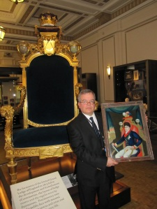 Andrew Tucker with Chinese reverse glass painting in front of George, Prince of Wales' ceremonial chair in Three Centuries of English Freemasonry Gallery Courtesy of The Library & Museum of Freemasonry
