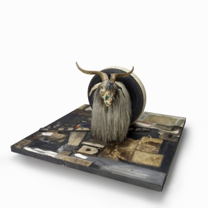 Monogram 1955-59 Combine: oil, paper, fabric, printed reproductions, metal, wood, rubber shoe-heel, and tennis ball on two conjoined canvases with oil on taxidermied Angora goat with brass plaque and rubber tire on wood platform mounted on four casters 106.7 x 135.2 x 163.8 cm Moderna Museet, Stockholm. Purchase with contribution from Moderna Museets Vänner/The Friends of Moderna Museet © Robert Rauschenberg Foundation, New York
