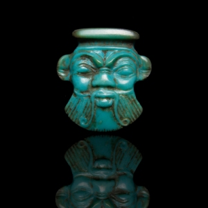 Egyptian Amulet of Bes, 2cm long x 1.9cm wide, Ptolemaic period, 332–30 BC, from Ancient & Oriental