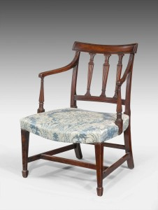 George III period mahogany framed elbow chair, the three upper splats to the back, well carved arms with fine reeding over shaped and turned uprights with block toes, c. 1790 Height34.00 inch(86.4 cm) Width24.00 inch(61.0 cm) Depth25.00 inch(63.5 cm)