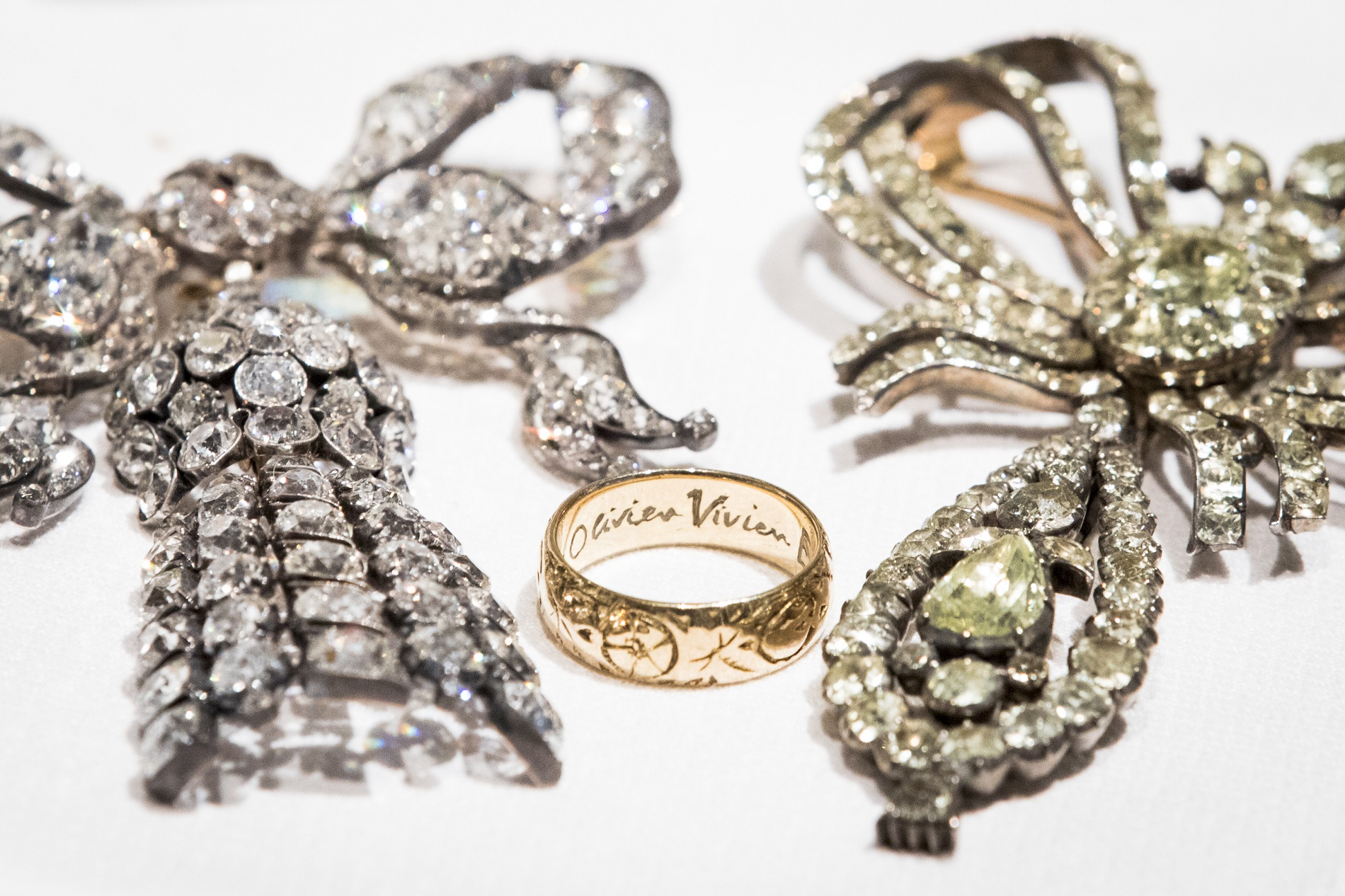 gold-ring-18th-century-chrysoberyl-devant-de-corsage-and-mid-19th-century- diamond-bow-brooch.jpg